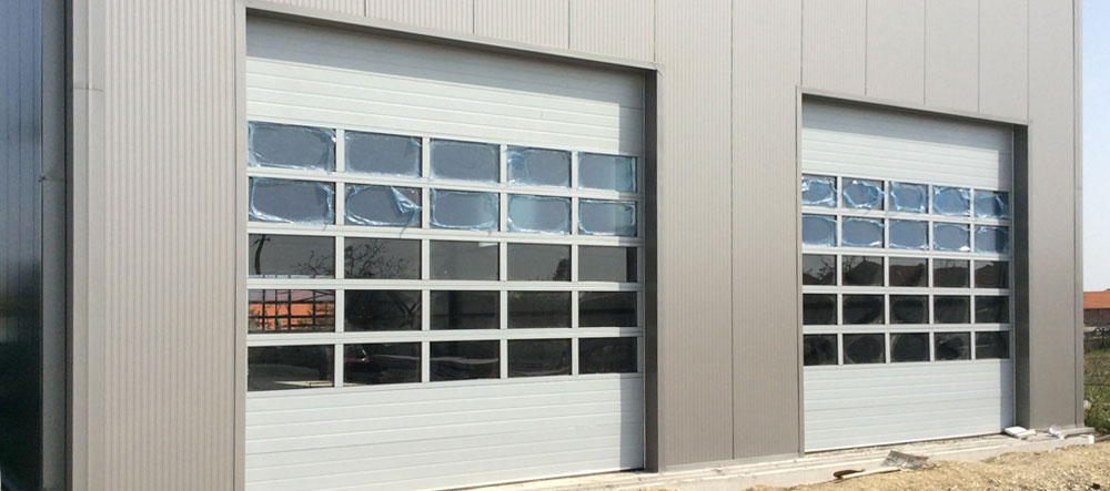 Sectional industrial overhead doors with insulation